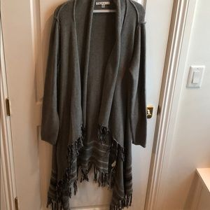 Cabi poncho sweater with exposed seams